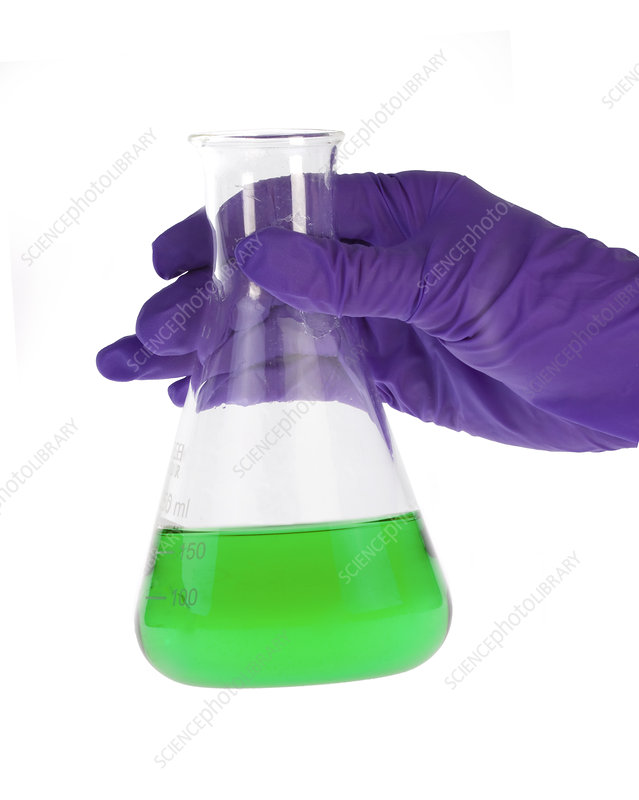 Conical flask in latex-gloved hand