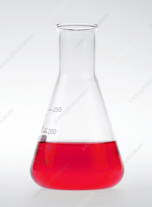 Conical flask holding red liquid