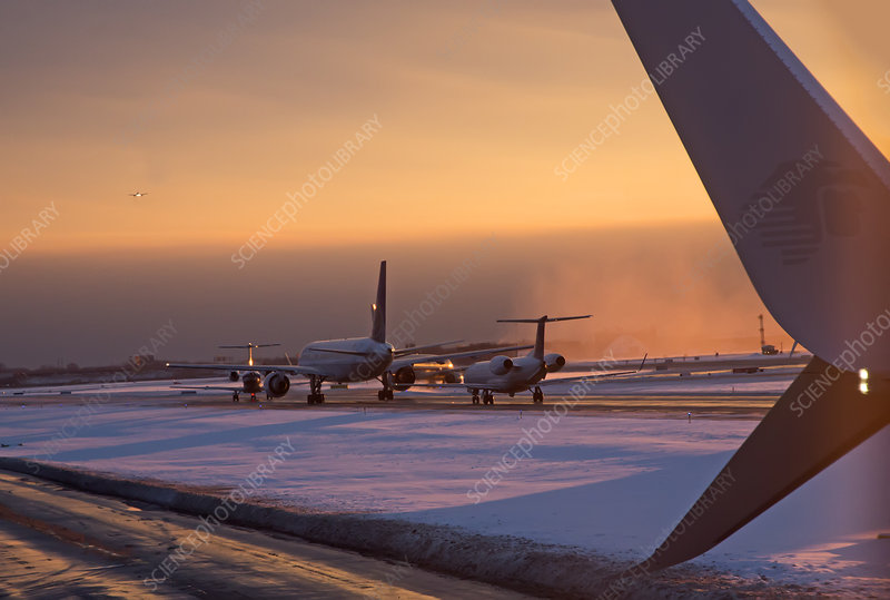 Passenger airliners taxiing at dawn