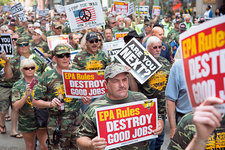 Miners rally against coal burning limits