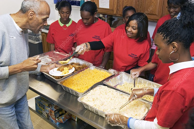Community volunteers serve food