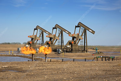 Gas flares and pumps at an oil field