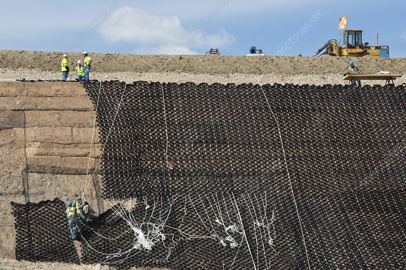 Workers stabilising a hillside