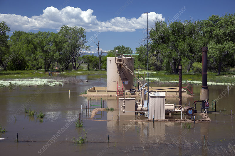 Oil well flooded by river, USA