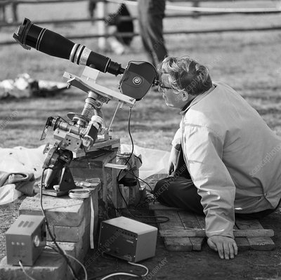 Astronomer watching solar eclipse