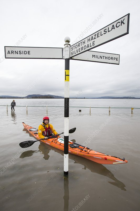 Kayakers in the flood waters