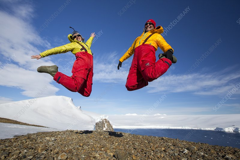 A man and woman jumping for joy
