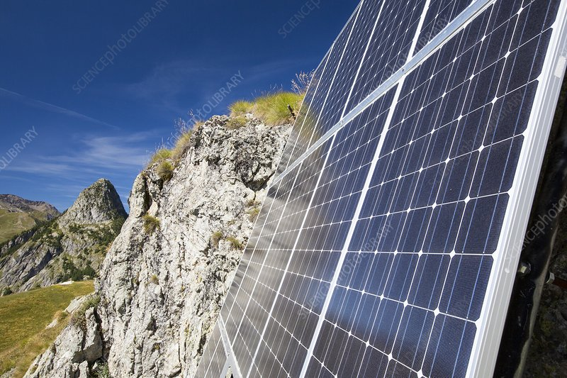 Solar panels attached to a cliff