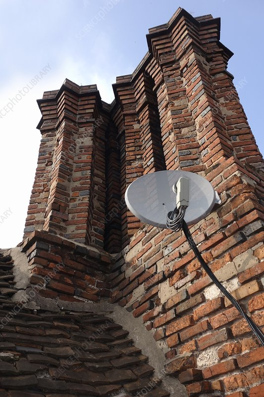 Tudor chimneys with satellite dish