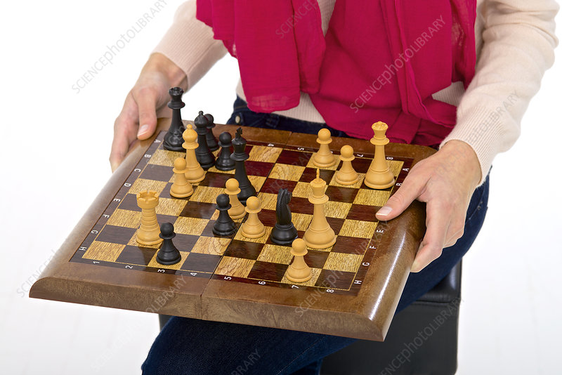 Woman holding chess board