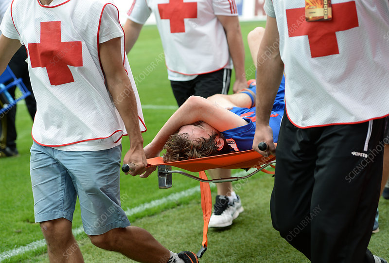Injured soccer player on a stretcher