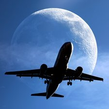 Moon and passenger plane