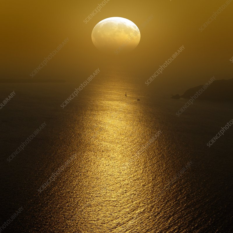 Moon setting over the ocean