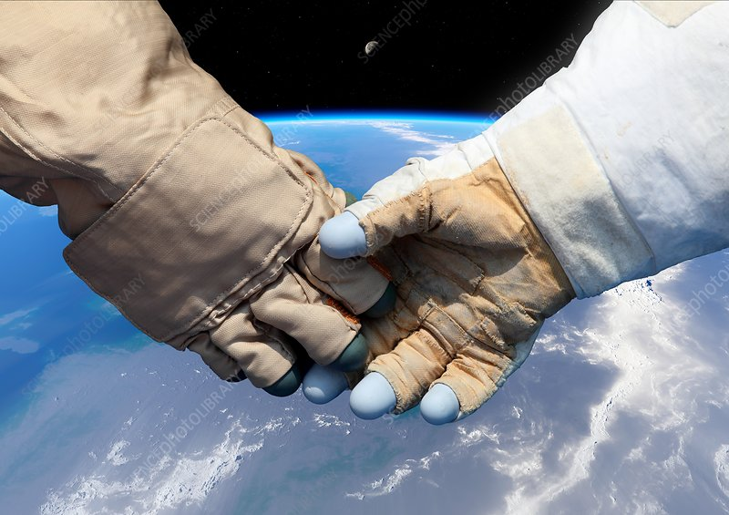 Cosmonaut and astronaut shaking hands