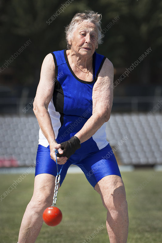 Elderly woman competitive weights thrower