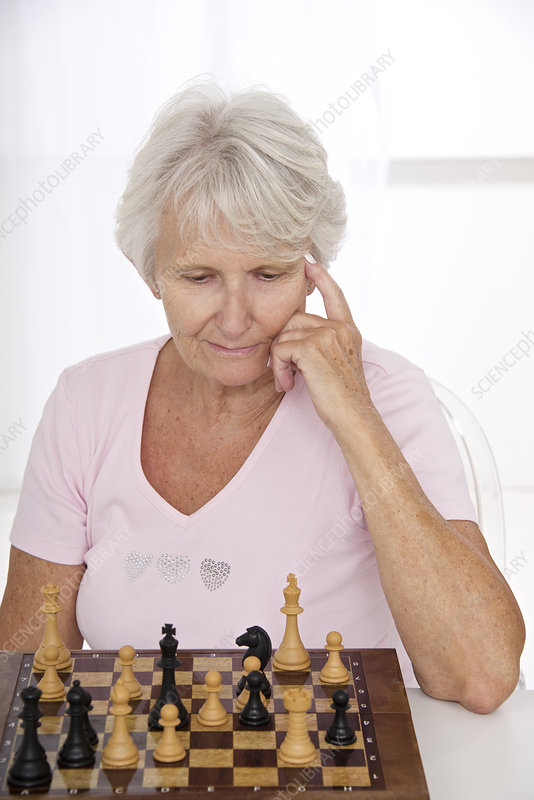 Older lady playing chess