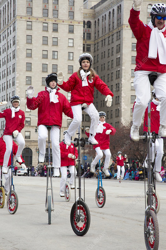 Unicyclists at a parade