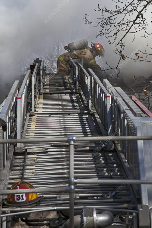 Firefighter on telescopic ladder