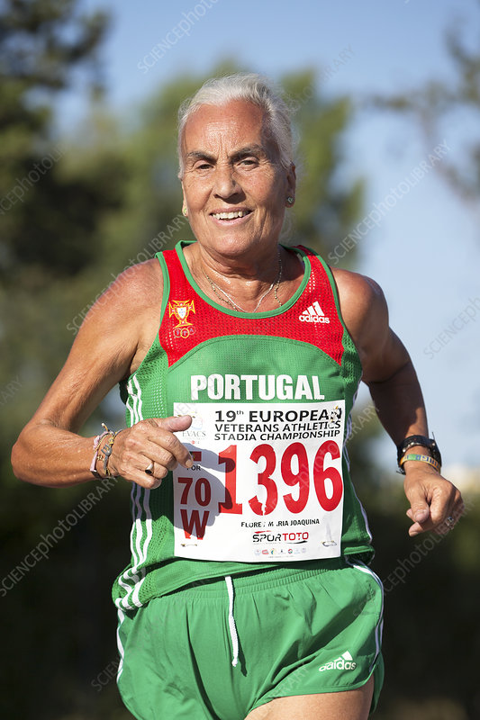 Smiling silver-haired female athlete