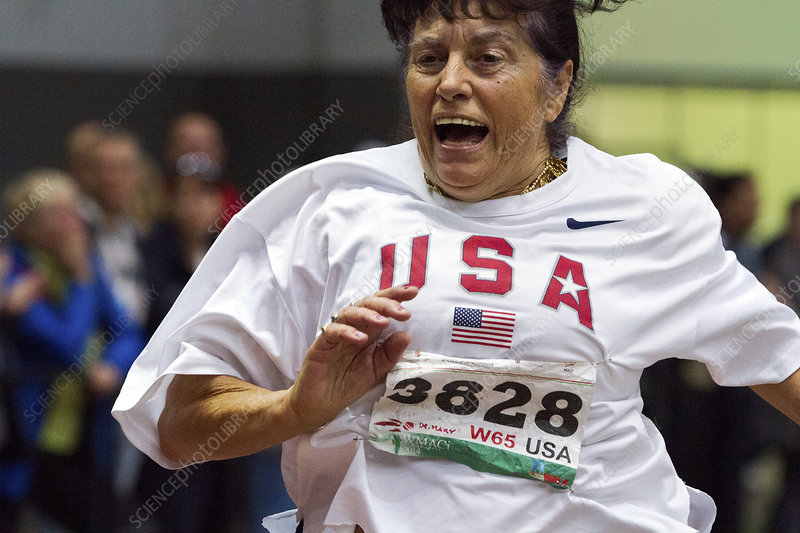 Joyful older female athlete running