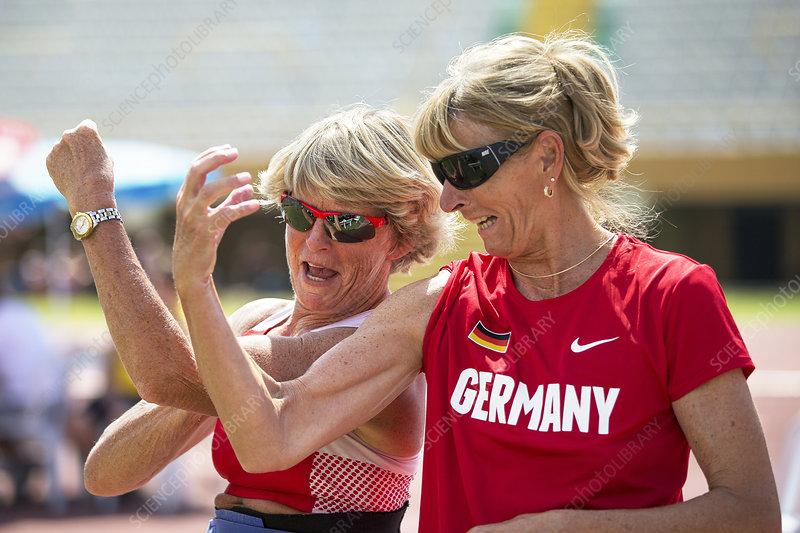 Senior female athletes compare biceps!