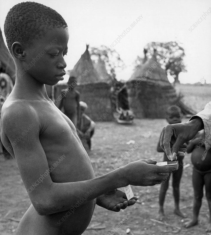 Boy with Leprosy Receiving Medication