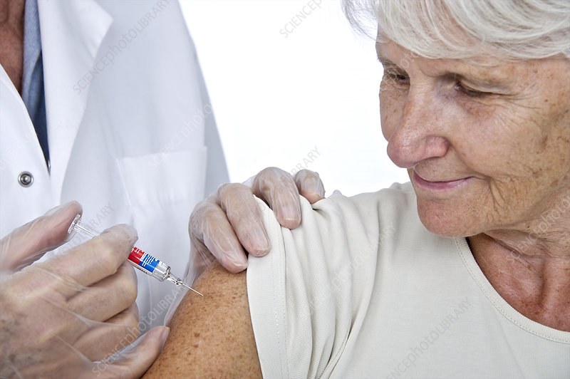 Elderly woman having an injection