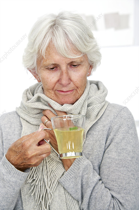 Elderly woman drinking hot lemon