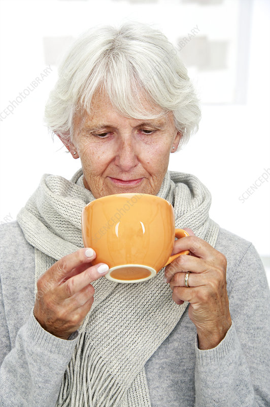 Elderly woman with a hot drink