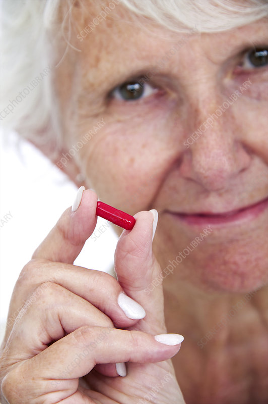 Elderly woman with medication