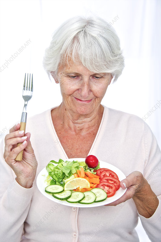 Elderly woman with a salad