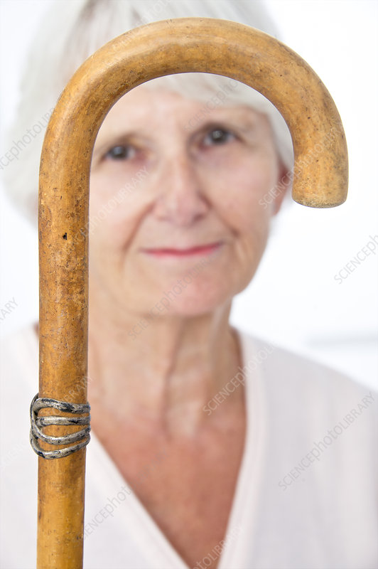 Elderly woman and walking stick