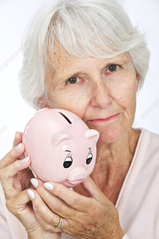 Elderly woman with a piggy bank