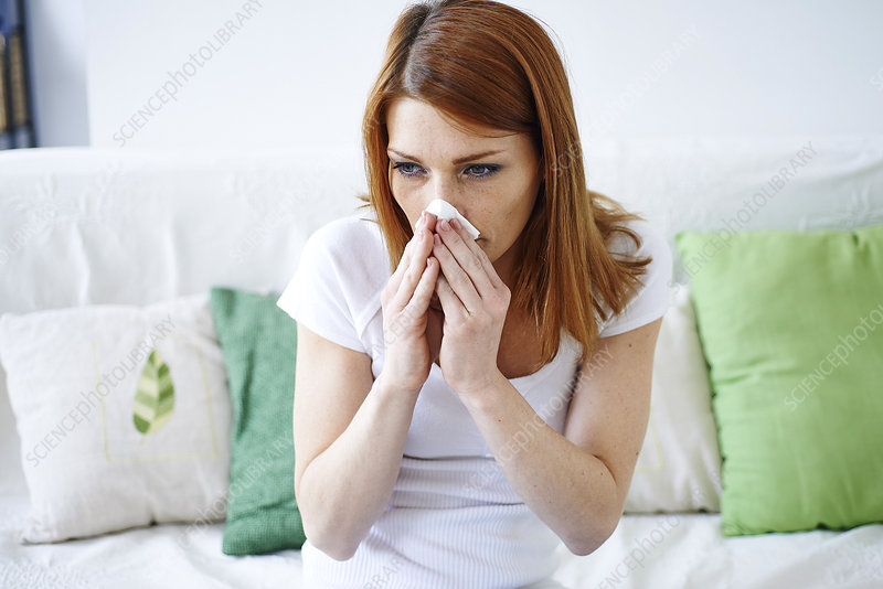 Woman with rhinitis