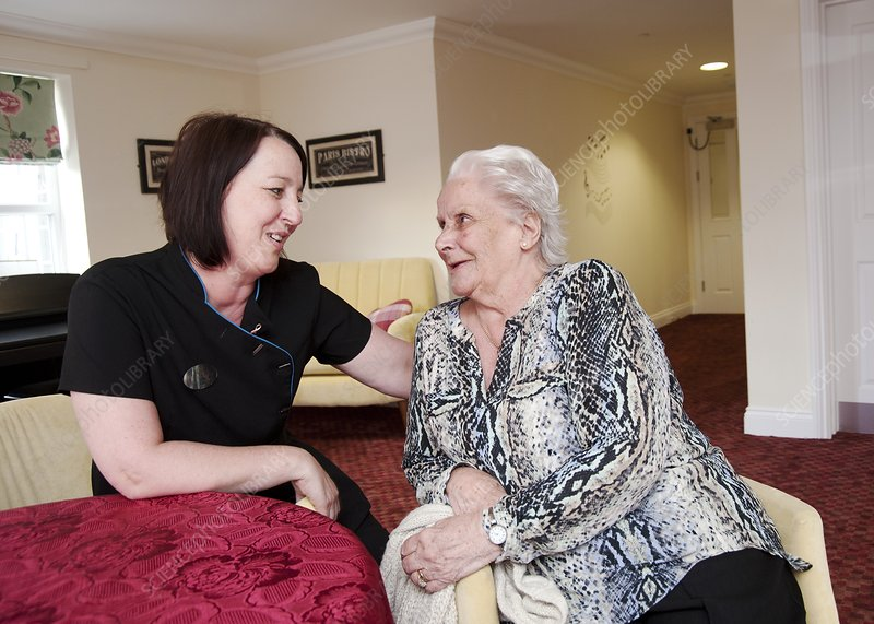 Care assistant with elderly woman