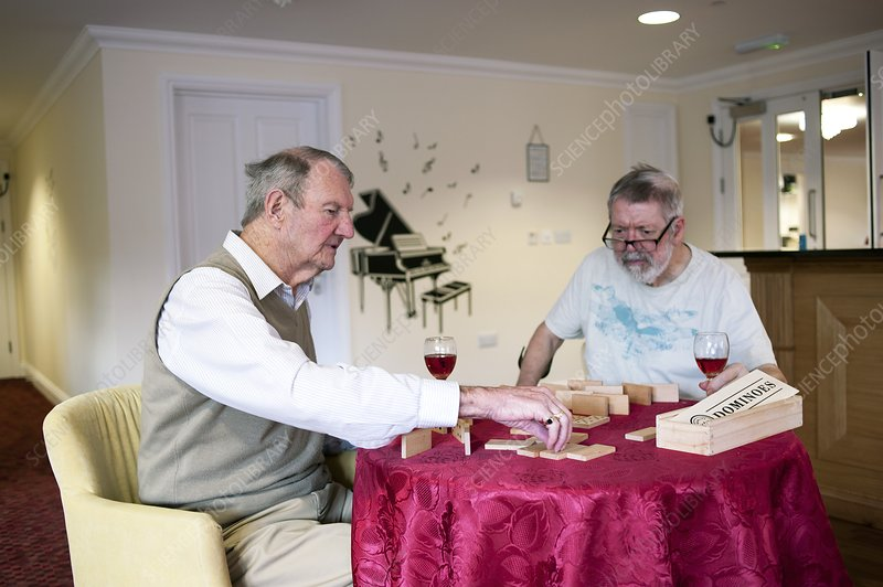 Elderly men playing dominoes