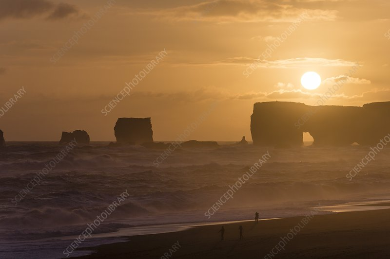 Sunset over arch and sea stacks