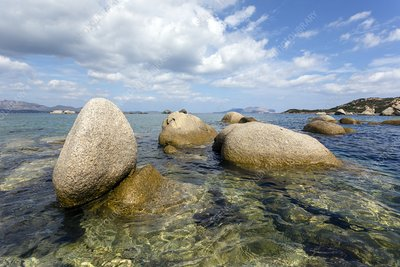 Round granite boulders on coast