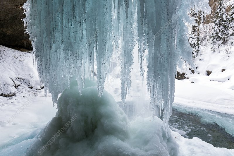 Icicles on freezing waterfall
