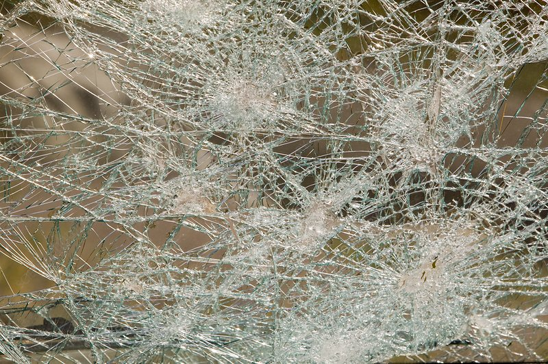 A vehicle with a smashed windscreen