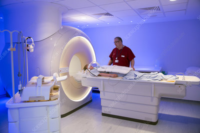 Radiographer preparing an MRI scan