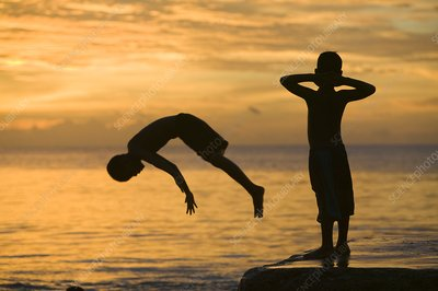 Tuvaluan children leaping into the sea