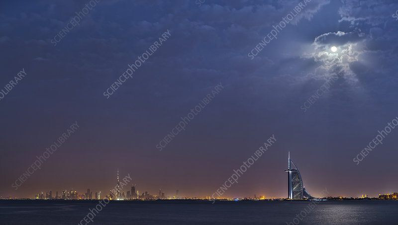 Moon over Dubai skyline