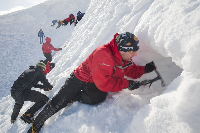 Mountaineers building snow holes