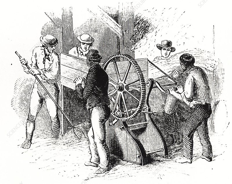 Hand-powered threshing machine