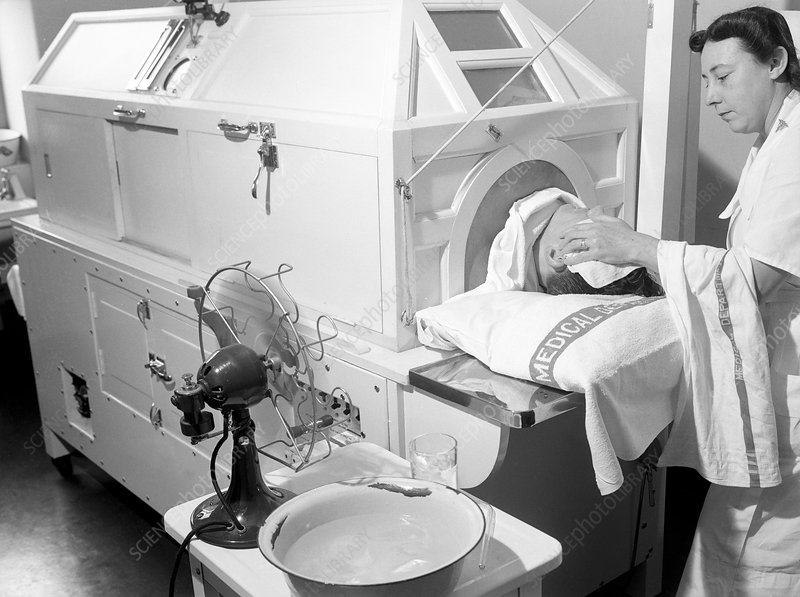 Patient in fever machine, 1940s