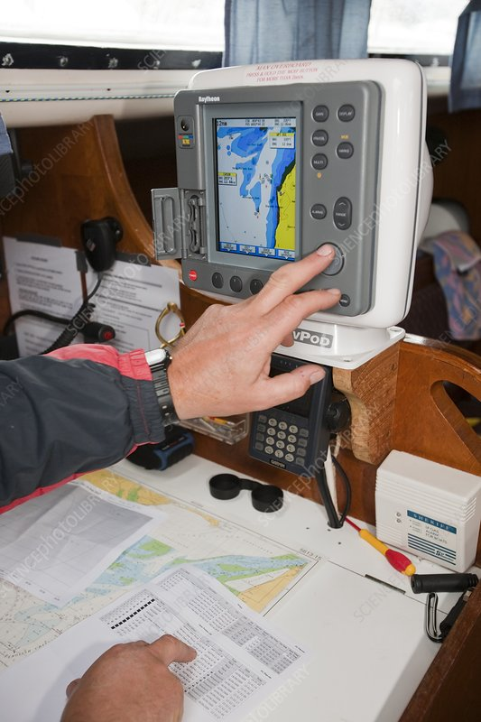 A sailor using GPS navigation equipment