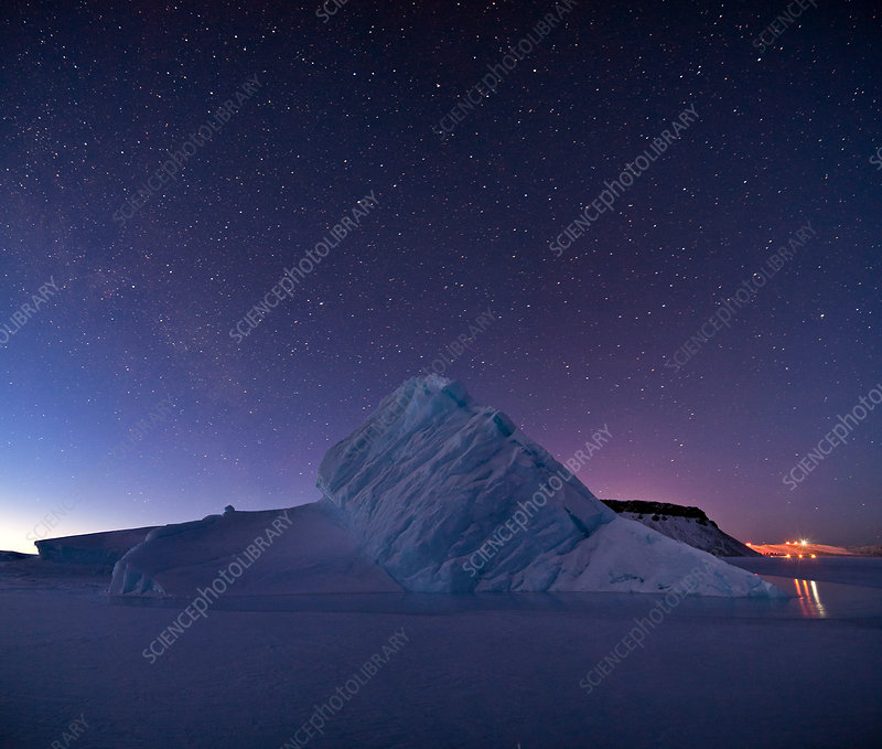 Night sky over iceberg, Greenland