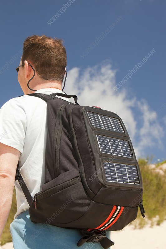A man carrying a solar backpack