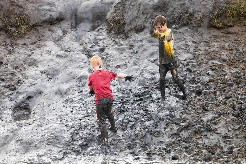 Children playing in a muddy creek